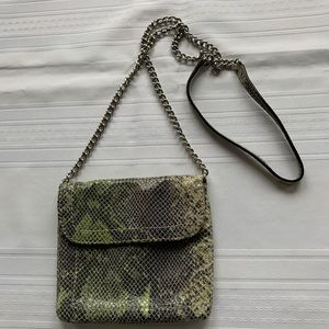Small leather bag with snakeskin imitation design.